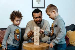 Small family builds a block tower